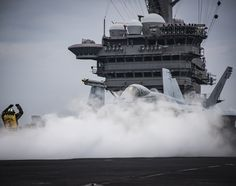 """170510-N-GD109-100 WESTERN PACIFIC (May 10, 2017) A F/A-18E assigned to the """"Golden Dragons"""" of Strike Fighter Squadron (VFA) 192 prepares to launch from the Nimitz-class aircraft carrier USS Carl Vinson (CVN 70) flight deck. The U.S. Navy has patrolled the Indo-Asia-Pacific routinely for more than 70 years promoting regional peace and security. (U.S. Navy photo by Mass Communication Specialist 2nd Class Z.A. Landers/Released)"""