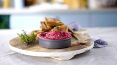 Recipe with video instructions: Nothing beats a beautiful, yummy dip made with sweet beets. Ingredients: 1 cup chickpeas, cooked, 2 medium beets, boiled, 1 Tbsp tahini, Juice of ½ lime, 1 small garlic clove, Salt, 3 ⅓ Tbsp olive oil, divided, Pita bread, 1 Tbsp white sesame seeds, Black pepper, Thyme leaves