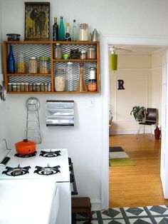 Crate shelf - love the idea of putting chicken wire or metal mesh behind it instead of slats.