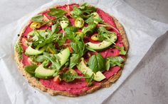 <p>This healthy pizza is composed of a cauliflower crust and topped with marinara and seasonal vegetables. </p>