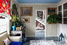 Sommers converted a storage room into a handsome passage with a purpose: Under a green chinoiserie mirror she set up a bar on an Italian marble-top console from Thomas Jolly Antiques.   - HouseBeautiful.com