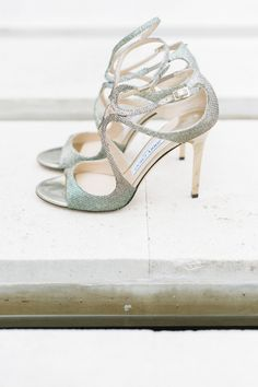 Sparkly silver Jimmy Choo shoes: http://www.stylemepretty.com/destination-weddings/spain-weddings/2015/11/28/traditional-church-wedding-romantic-beachside-reception-2/   Photography: Ana Lui - http://analuiphotography.com/