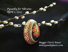 "I began writing pysanky as a girl of 12, my mother took me to I learn from a gentleman at our Ukrainian Center...my love for pysanky began that day.  My Pysanky for Ukraine is Written with the Intention for Peace and Unity in Ukraine""-A broad side ""band"" using the ancient ""star pattern"".The band means eternal harmony.  The star signifying success.  I used more than four color dyes on the goose egg.  This combination of colors represents protection, family, peace and love."