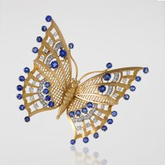 French Art Deco 18 karat gold brooch with blue sapphires and diamonds Mauboussin 1930's