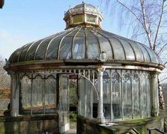 Not abandoned but in disrepair Victorian greenhouse in Scotland