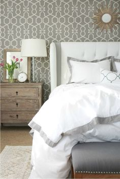 Crisp bedroom with rug over carpet