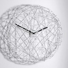 "Ci Vediamo now featured on Fab.Meaning ""we'll see each other"" in Italian, the Ci Vediamo Clock, designed by Antonino Sciortino for Diamantini & Domeniconi, presents time as if it were trapped. Constructed with a circular white wire mesh, a mini quartz movement and black hour and minute hands, this unusual design lends a sculptural look to the traditional wall clock."