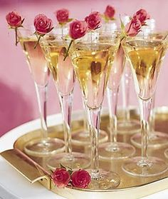 Time for a toast. Champagne topped off with tiny tea roses. New Year's Eve celebration idea