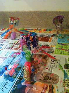 Octopus Craft with Water Bottle this would be a cute craft to do while babysitting to keep the kids busy :)