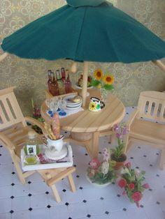 Dollhouse Miniature Four Piece Patio Set Table Rocking Chair Lounger and Umbrella. $39.95, via Etsy.