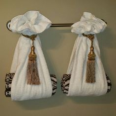 Hanging bathroom towels decoratively with drapery tassels is a great way to disp. - Decorating Towels For Bathroom - Bathroom Towel
