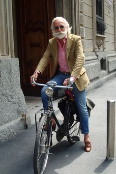 Cycling like Mr. Alborghetti. I am letting my white hair, beard, and mustache grow out and so the hair, beard and mustache on this man is basically the way mine looks now.