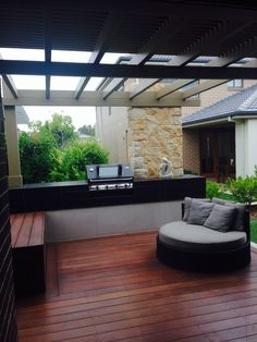 Outdoor area - deck, painted wooden patio structure, no roof just slats, BBQ area