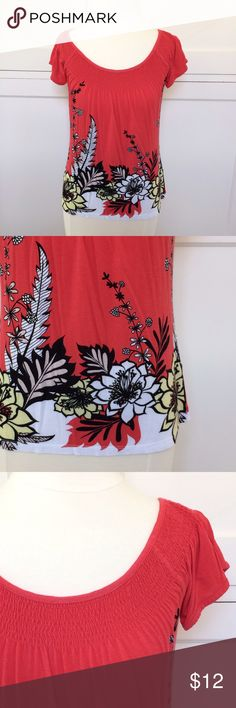 """H&M Orange Floral Top NO TRADES. OFFERS WELCOME. PLEASE USE THE OFFER BUTTON. I DO NOT NEGOTIATE PRICE IN THE COMMENTS. Casual top from H&M with smocking at neckline. Cap sleeves. Super-soft tee material. Relaxed fit. Unlined. 21"""" long, 17"""" across at bustline. 100% rayon. Machine wash warm, line dry. Size small. Pre-loved, in great condition. H&M Tops Tees - Short Sleeve"""