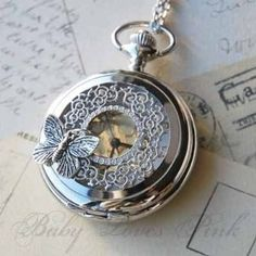 Bright silver pocket watch inspired by the butterfly effect theory. The watch cover filigree is embellished with a beautiful silver butterfly. Simply press the top notch to reveal the face of the watch. Watch comes gift wrapped ready for gift giving. Pocket Watch Necklace, Silver Pocket Watch, Pocket Watch Art, Vintage Pocket Watch, Cute Jewelry, Jewelry Accessories, Watch Crown, Style Steampunk, Steampunk Watch