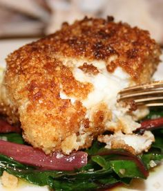 Baked halibut with herb-almond crust.Halibut fillet with herbs and almonds baked in the oven.