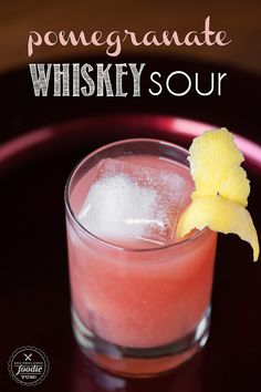Perfect for the winter holidays, mix up an easy to make Pomegranate Whiskey Sour.