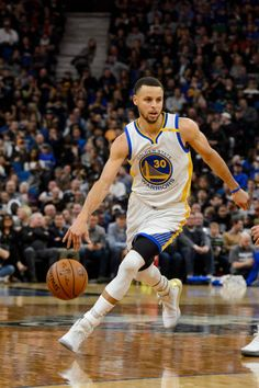 Stephen Curry of the Golden State Warriors dribbles the ball against the Minnesota Timberwolves during the third quarter of the game on March 10 2017...
