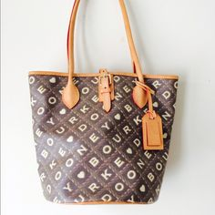 Dooney and Bourke Shoulder Purse This bag is authentic and beautiful. It is in brand new condition. It has a serial number inside. Real leather on handles and so soft. Red interior. Ask for more pictures if you need. Dooney & Bourke Bags Shoulder Bags