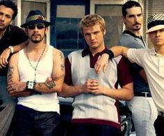 backstreet boys<3 I was in love with them.....well BRIAN LITTRELL <3    And I knew every word to every song :]  1st concert ever :]