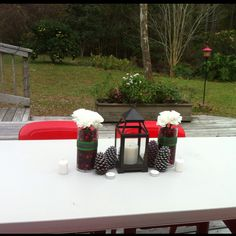 Table decorations done by me! Cranberries, and carnations with spray painted and glittered Pine cones with lantern