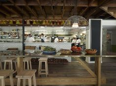 CHISWICK Restaurant, AU. View into the kitchen from the communal table.