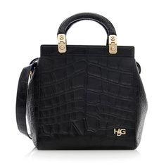 This collectible House de Givenchy (HDG) bag is a coveted piece from the Spring/Summer 2014 Collection. Inspired by the native Italy environment in 1970, this clean-lined tote is made from black croc embossed leather with gold-tone hardware. Details include two flat handles, a zip closure, and suede lined interior with two open and one zip pocket. Wear this style on the forearm or over the shoulder with a detachable strap.