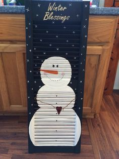Painted snowman on shutter