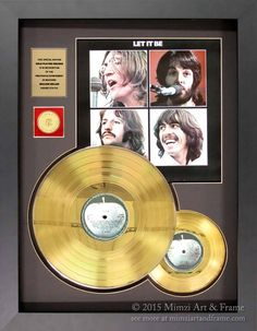 A commemorative set of Beatles gold records gets an update with a chunky black frame to replace a small and dated looking frame in our client's collection.