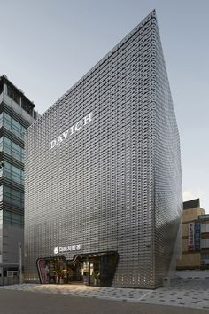 Look closely and you'll notice the #facade of this optical chain #building is a perforated pattern of eye glasses.
