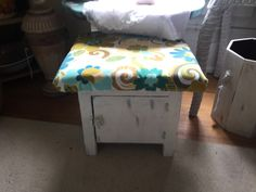 Repurposed small cupboard into a footstool with storage.