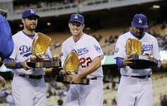 Dodger rightfielder Andre Eithier, left, pitcher Clayton Kershaw, center and center fielder Matt Kemp hold their Golden Glove Awards before the game against the Padres April 13, 2012.