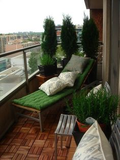 Balcony With a View. Ummm I wonder if 'fake' cedars would look okay on my North facing balconies were everything dies?