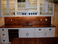Patina copper countertop with integral square sink and quilted backsplash