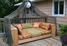 outdoor pallet daybed  awesome...guys would love this!