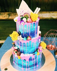 With bright colour drips, technicolour flowers and fun fruit garnishes, this galaxy cake is the boho bride's dream.