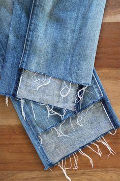 DIY uneven jean hems.