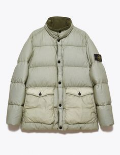 """Jacket from <a href=""""http://tres-bien.com/stone-island/"""" class=""""uniquelink"""">Stone Island</a>. Garment dyed. Funnel neck with moleskin lining. Two-way zip closure and snap buttons on the front. Two flapped and buttoned front pockets with top and side openings. Removable logo patch on the left sleeve. Ribbed cuffs. Down padded. One inner pocket. Straight hem."""