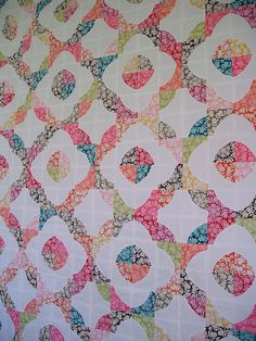 Drunkard's Path Quilt Top by jenniferworthen, like how the boarder is the busy print instead of the main block/pattern