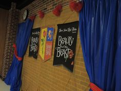 Beauty and the Beast Cast Party  Photo wall / Photobooth Backdrops are table cloths from the dollar store.  Prints are inexpensive ( under $5) engineer prints from STAPLES.