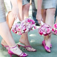 Pink hydrangeas, roses, mini callas, spray roses & zebra grass. Cute bridesmaids bouquets!