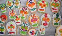 Lots of beautifully decorated sugar skull cookies make with MexicanSugarSkull.com exclusive symmetrical cookie cutters.