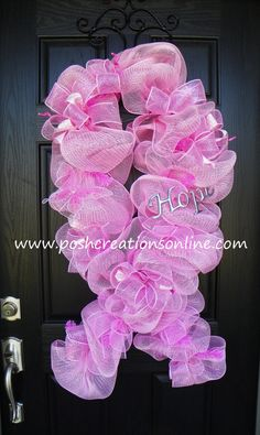 Think this would be a great fundraiser & not too difficult to make Breast Cancer Awareness Wreath Pink Ribbon. $70.00, via Etsy.