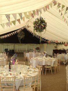 Stunning hanging flower displays create the wow factor in this summer #Wedding marquee
