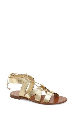 Obsessing over these gold Kate Spade strappy sandals perfect for warm-weather outings. A lace-up front provide a chic, adjustable fit.