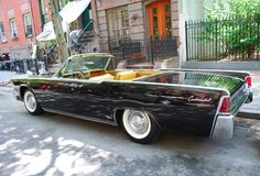 Love this car (1961 Lincoln Continental Convertible with suicide doors), and love this blog for all its sexy vintage car pictures. purrrrr