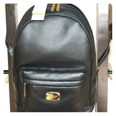 "Michael Kors Large Jet Set Black Leather Backpack Michael Kors large black leather ""Jet Set"" backpack. This is BRAND NEW, never been worn!!!  It's gorgeous and the leather is soft! Approx. 11.5"" (L) x 15"" (H) x 5"" (W). Double adjustable shoulder straps with exterior zipper pockets. Interior pockets for organization. No trades! Michael Kors Bags Backpacks"