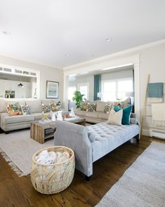 Stylish family room with neutral base, pops of color, and reclaimed wood that is both chic and family friendly
