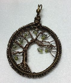 Bronze tree of life pendant with green leaves by DesignsByShellyM
