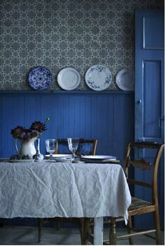 Strong Mediterranean characterful touches: Indigo walls, Aegean blue doors and hard to find plates w/ traditional design!